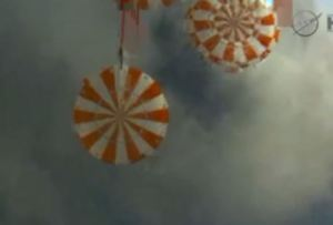 Orion capsule parachutes deployed.