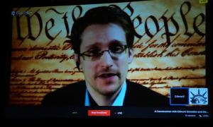 What's wrong with this picture? Snowden beamed into SXSW conference to talk about freedom.